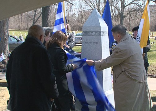 Ioanna Efthymiadou, Consul General of Greece, and John Scocos, unveiling the memorial obelisk.